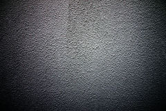 Old cement wall texture of dark color. Stock Photo