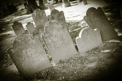 Old Cemeteries - Tombstone Closeups. Closeups of old tombstones in a very old cemetery; photo done in halloween or seasonal colortones royalty free stock photo