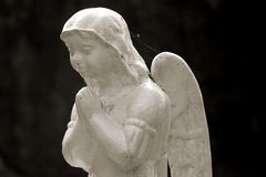 Old cemetery angel sculpture made of stone Stock Image