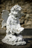 Old cemetery angel sculpture made of stone Royalty Free Stock Images