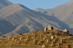 Old cemetery with clay gumbezes - traditional tombs,Osh region,Kyrgyzstan royalty free stock photography