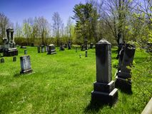 An old cemetery in the countryside. On a beautiful day I was walking on the country roads of the Eastern Townships. This place was like lost. Fortunately I was royalty free stock photos