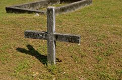 Old cemetery cross and tomb Stock Photos