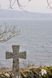 Last sea view. Old cemetery on the Isle of Skye in Scotland with overwhelming sea view royalty free stock images