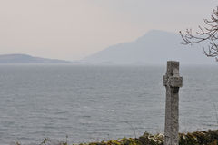 Last sea view. Old cemetery on the Isle of Skye in Scotland with overwhelming sea view royalty free stock photo