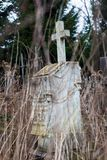Old cemetery marble gravestone with the cross Royalty Free Stock Photos