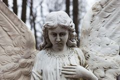 Old cemetery marble sculpture of the angel.  Royalty Free Stock Photos