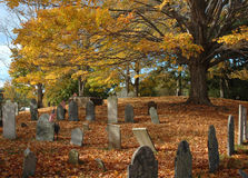 Old Cemetery in October. Old New England cemetery under a canopy of fall foliage in late October stock photography