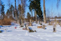 Old cemetery of old believers in Latgale covered with snow, Latvia 2018 stock images