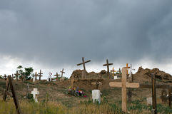 Old cemetery in storm. A view of an old cemetery with many wooden crosses as a dramatic thunderstorm approaches Stock Images