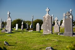 Antique Christian graveyard with old tomb stones at daytime, in Ireland Royalty Free Stock Photos