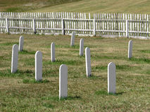 Old cemetery white headstones in a field. Stock Image