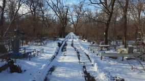 Old cemetery in winter time. Steadicam shot stock video