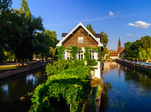 Old center of Strasbourg. Typical alsacien houses on the river. Royalty Free Stock Photos