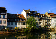 Old center of Strasbourg. Typical alsacien houses on the river. Stock Photos