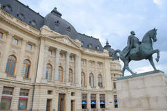 Old Central University Library and statue of king Carol I of Romania. In Bucharest, capital city of Romania. Royalty Free Stock Photography