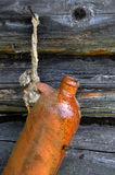 Old Ceramic Bottle On The Wall Stock Image