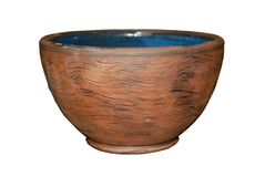 Old ceramic clay bowl in folk style isolated. Old ceramic clay bowl with blue glaze on the inner surface in folk style isolated Royalty Free Stock Images