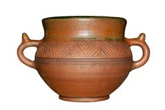 Old ceramic clay pot in the folk style isolated. Old ceramic clay pot with handles in the folk l style isolated Royalty Free Stock Photography