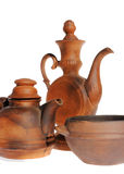 Old ceramic, clay teapot on the white Royalty Free Stock Photography