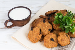 Old ceramic cups of milk and freshly baked oatmeal raisin cookies Royalty Free Stock Photo