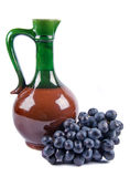 Old ceramic decanter with grapes Stock Images