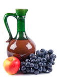 Old ceramic decanter with grapes Royalty Free Stock Photo