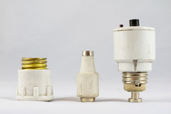 Old ceramic electric fuses on white background stock photography