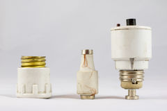 Old ceramic electric fuses on white isolated background Royalty Free Stock Photo