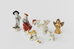 Old ceramic figurines on a white background royalty free stock images