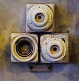 The old ceramic fuses on a wall Stock Images
