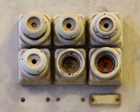 The old ceramic fuses on a wall Royalty Free Stock Photography