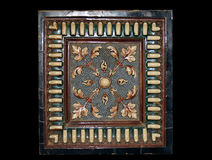Old ceramic tile. From oven. Black background Royalty Free Stock Photo