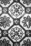 Old ceramic tile with black-and-white pattern Royalty Free Stock Image
