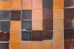 Old ceramic tile on floor Stock Photo