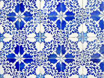 Old ceramic tiles. Old typical portuguese tiles called azulejos taken from the external walls of an old house in Lisbon Royalty Free Stock Image