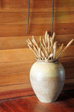 Old ceramic vase on wooden floor Royalty Free Stock Images