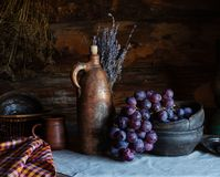 Still life in a rustic style. ceramic dishes and  fruits stock images