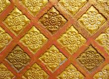 Old ceramic wall. Gold and red painted Stock Photo