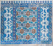 Old ceramic wall tiles with floral blue pattern in an exterior wall of the historic Eyup Sultan, Istanbul, Turkey Stock Images