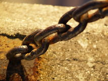 Old chain. Old oxidized chain fixed to the wall Royalty Free Stock Image