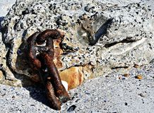 Old Chain Links in Concrete on Beach. When collecting mussels on Scarborough beach on the Atlantic seaboard in Cape Town we came across these old chain links set Stock Photo