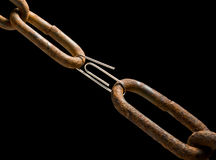 Old chain and new paperclip. Weak or strong link concept Stock Photos