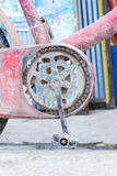 Old chain wheel of bicycle with dry mud Stock Image