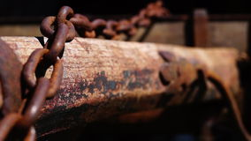 Old chain. On wooden barrow stock footage