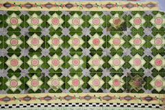 Old chainess tile. Old Chinese tiles with pink flower and green pattern Royalty Free Stock Images