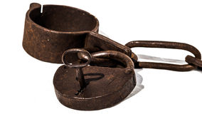 Old chains, or shackles, with padlock and key Royalty Free Stock Photography