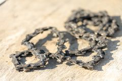 Old chainsaw chain. Place for your text.  stock photo