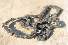 Old chainsaw chain. Place for your text.  royalty free stock image