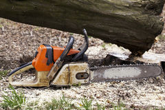 The old chainsaw. Is on a ground stock photo